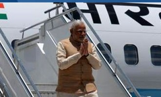 Modi arrives to a rousing welcome in Bhutan