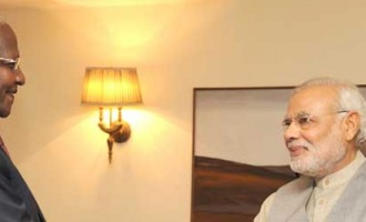The Foreign Minister of Uganda, Dr. Sam Kutesa calling on the Prime Minister, Narendra Modi, in New Delhi
