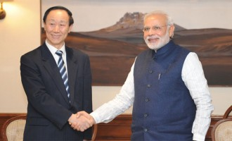 Visiting Chinese leader calls on Modi
