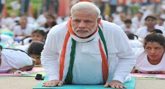 Yoga helps 'confidently negotiate challenges' : PM Modi
