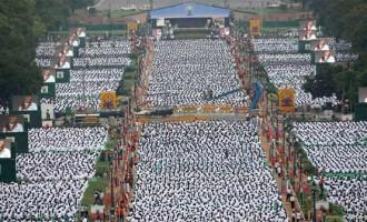30,000 bring yogic calm to the frenetic 'Crossroads of the World'