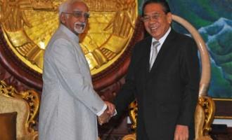 Vice President, Mohd. Hamid Ansari meeting the President of Lao PDR, Choummaly Sayasone