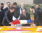 President of France, Francois Hollande laying wreath at the Samadhi of Mahatma Gandhi, at Rajghat, in Delhi on January 25, 2016.
