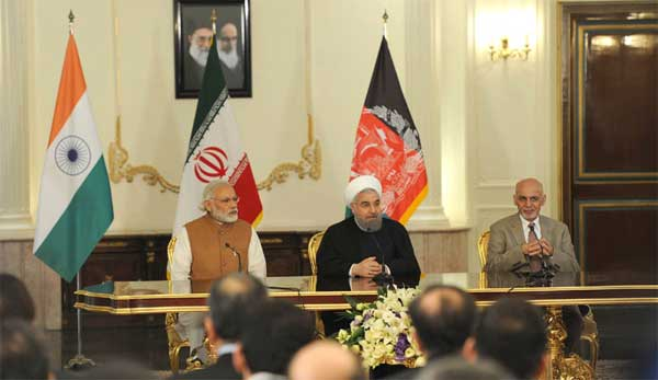 The Prime Minister, Narendra Modi with the President of Iran, Hassan Rouhani and the President of Afghanistan, Dr. Mohammad Ashraf Ghani, witnessing the signing of Trilateral Agreement between India, Afghanistan and Iran, in Tehran.