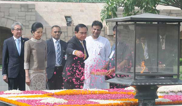 The Prime Minister of the Kingdom of Thailand, General Prayut Chan-o-cha paying floral tributes at the Samadhi of Mahatma Gandhi, at Rajghat, in Delhi on June 17, 2016. Mrs. Naraporn Chan-o-cha is also seen.