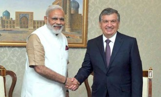 Prime Minister, Narendra Modi in a brief meeting with the Prime Minister of Uzbekistan, Shavkat Mirziyoev,