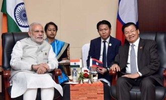 Prime Minister, Narendra Modi meeting the Prime Minister of Lao PDR, Thongloun Sisoulith, at Vientiane