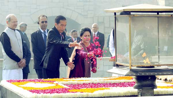 The President of Indonesia, Joko Widodo paying floral tributes at the Samadhi of Mahatma Gandhi, at Rajghat, in Delhi on December 12, 2016. The Minister of State for Environment, Forest and Climate Change (Independent Charge), Anil Madhav Dave is also seen. The President of Indonesia, Joko Widodo paying floral tributes at the Samadhi of Mahatma Gandhi, at Rajghat, in Delhi on December 12, 2016. The Minister of State for Environment, Forest and Climate Change (Independent Charge), Anil Madhav Dave is also seen.