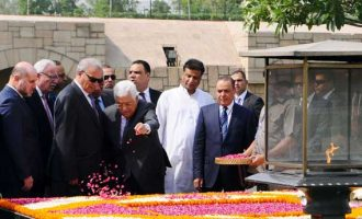 President of the State of Palestine, Mahmoud Abbas paying floral tributes at the Samadhi of Mahatma Gandhi,