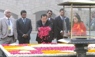 Prime Minister of the Kingdom of Cambodia, Samdech Akka Moha Sena Padei Techo Hun Sen paying floral tributes at the Samadhi of Mahatma Gandhi