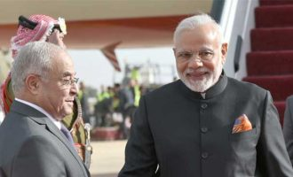 Prime Minister, Narendra Modi being received by the Acting Prime Minister of Jordan, Dr. Mamdouh Al Abbadi