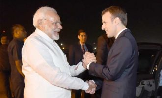 Modi breaks protocol, receives French President at airport