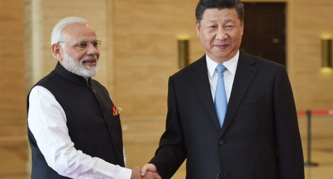 Modi invites Xi to India, discusses bilateral ties