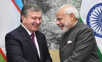 The Prime Minister, Narendra Modi meeting the President of Uzbekistan, Shavkat Mirziyoyev