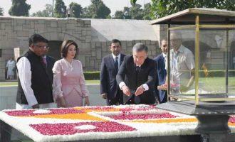 The President of the Republic of Uzbekistan, Shavkat Mirziyoyev paying floral tributes at the Samadhi of Mahatma Gandhi