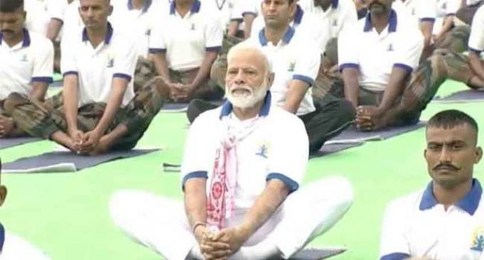 India performs yoga with Modi on International Yoga Day
